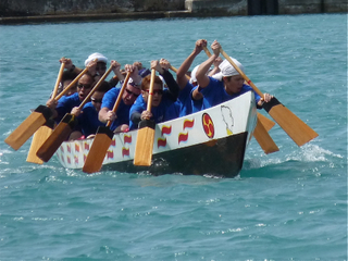 Photo of men's team rowing